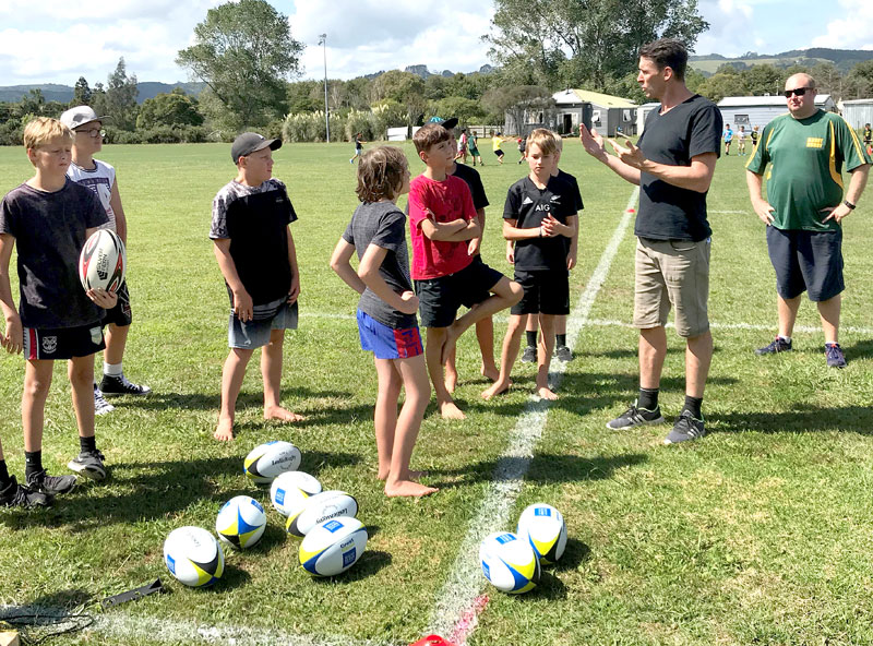 John Leslie running a junior rugby coaching session at Drury, Auckland.