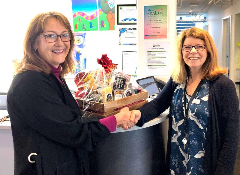 Linda Hill, Crest's Auckland East Regional Director, with Margaret Walker and the prize hamper.