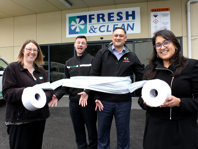 Alsco staff, Michelle Barwood, telesales and service co-ordinator, David Gluyas, Wellington branch manager, Robbie Semu, territory manager, with CrestClean's Wellington and Hutt Valley Regional Manager Zainab Ali.