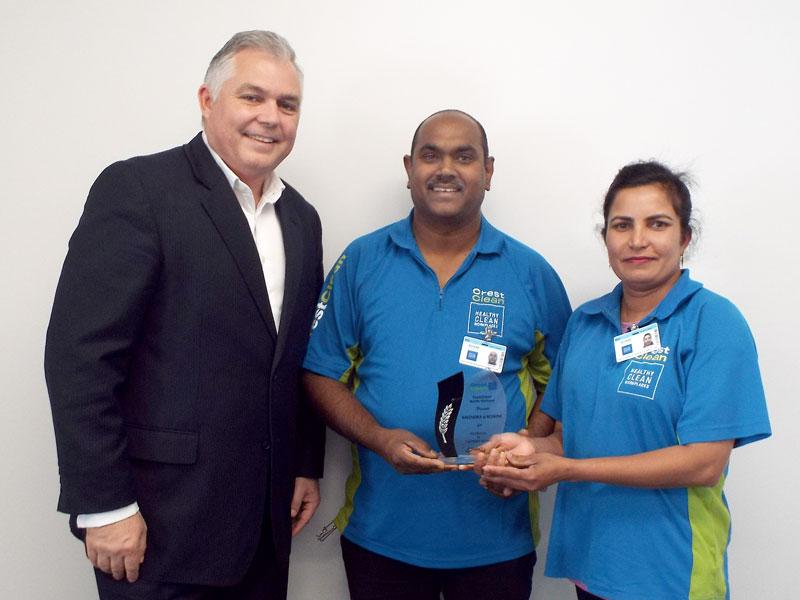 MP Mark Mitchell presents an award to Ravendra Prasad and Roshni Devi Prasad