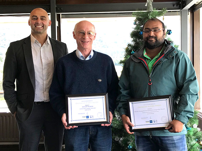 Donald Nicolson, celebrating five years with CrestClean and Murali Narayanan, celebrating three years. With them are Tony Kramers, CrestClean's Dunedin Regional Manager.