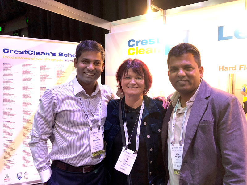 CrestClean's Yasa Panagoda and Viky Narayan with conference delegate Liz Wood from Bruce McLaren Intermediate School, Henderson.