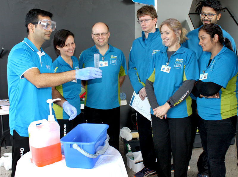The correct way to dilute and prepare cleaning products is demonstrated by trainer Pinakin Patel at the Tauranga event.