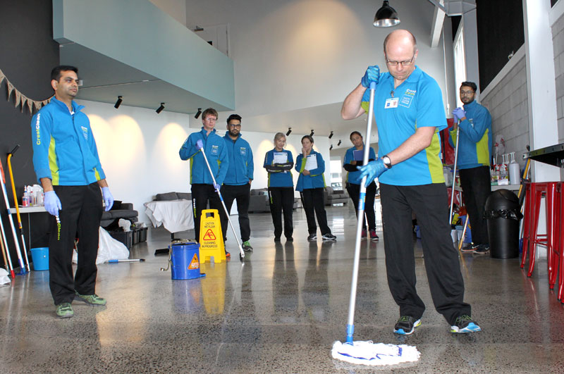 Pinakin Patel keeps a watchful eye as franchisees get to grips with mopping during the training day.