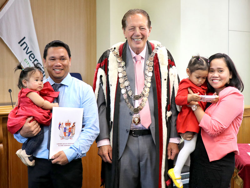 Cons Novilla and his wife Christine with children Chassy and Chloe receive their New Zealand Citizenship from Invercargill Mayor Tim Shadbolt. Photo: Invercargill City Council