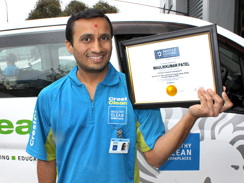 Maulik Patel is proud of his training award from Master Cleaners Training Institute.