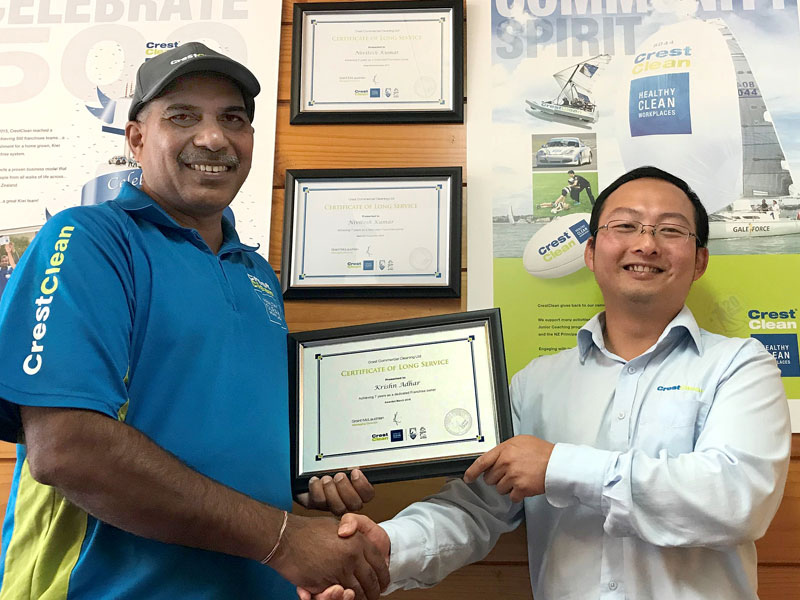 Krishn Adhar receives his long service award from Jason Cheng, a CrestClean Quality Assurance Coordinator for the Waikato.