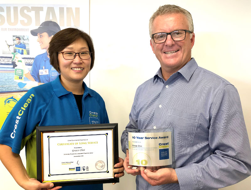 Grace Choi receives her Certificate of Long Service from Grant McLauchlan, CrestClean's Managing Director.