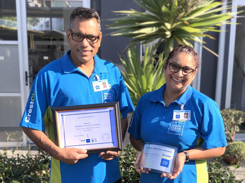 Madukesh Kumar and Irene Roshni with their long service award.