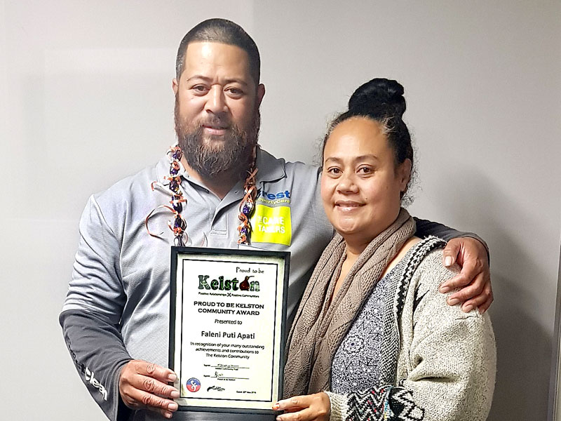 Puti Apati and his wife Seiolita with their community award.