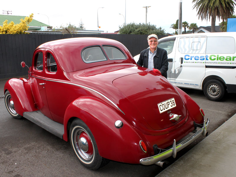 Marty Perkinson parks his 1938 Ford V8 Coupe Flathead next to a CrestClean van.