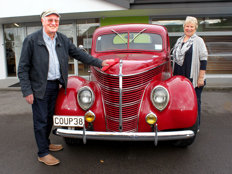 Marty and his wife Anne take a break at CrestClean's Tauranga office during their road tour.