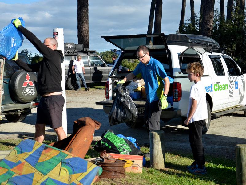 Dominik Drahoninsky with other volunteers at Muriwai Beach.