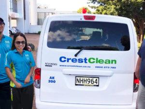 Cleaner franchisees beside their van.