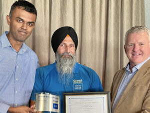 Cleaner is presented with certificate.